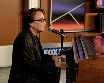 Rich Spina performs on Fox  8