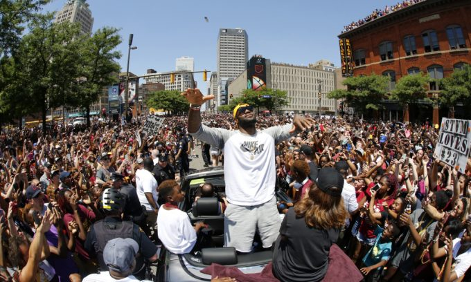 """LeBron greeting the fans during the parade on June 22"""