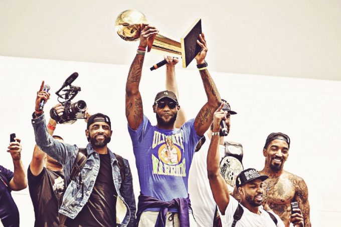 """The world champion Cavs hoisting the trophy!!!"""